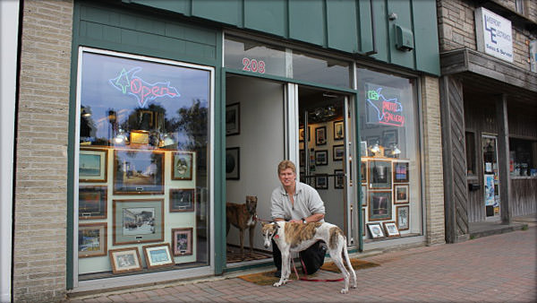 David Black pictured in front of his store with his Greyhounds